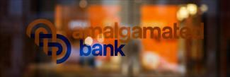Amalgamated's bank logo on a glass window.